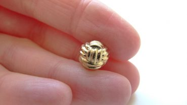 Botón Nudo Oro-plata