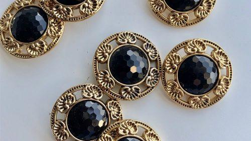 Botón Chanel Oro-strass Negro
