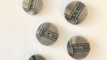Botón Pespunte Metal