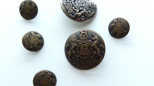 Botón Leones Metal